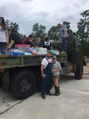 Tamara Perry and her husband Michael use their deuce and half to help transport food, supplies, and water into areas t...