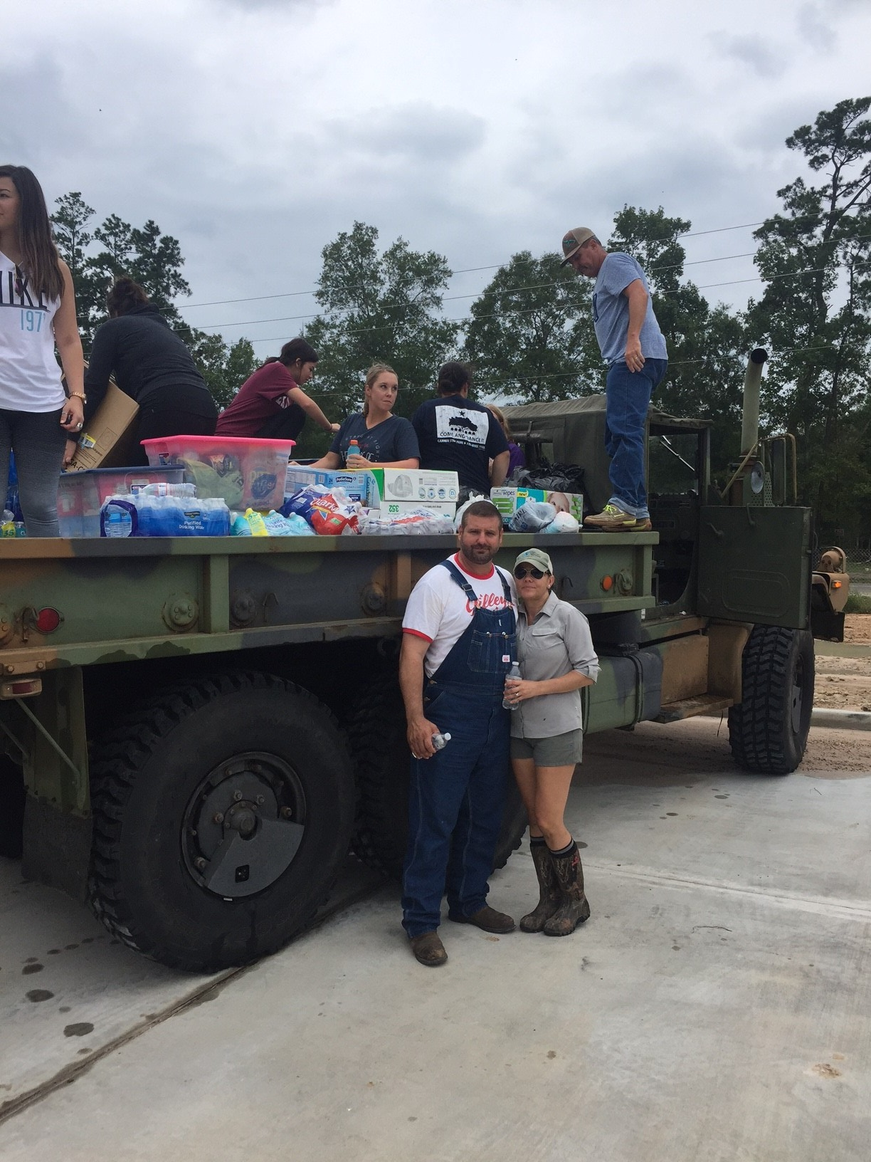 Tamara Perry and her husband Michael use their deuce and half to help transport food, supplies, and water into areas tha…