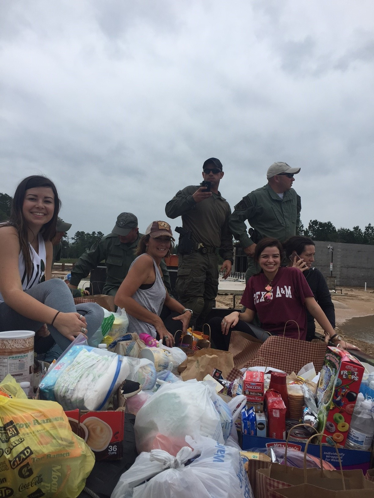 Volunteers and the Texas Rangers are transported along with food and supplies into areas land locked by flooding waters.